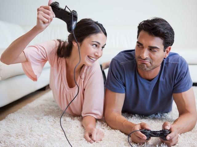 Cuplu jucand jocuri video Foto: www.bigfishgames.com
